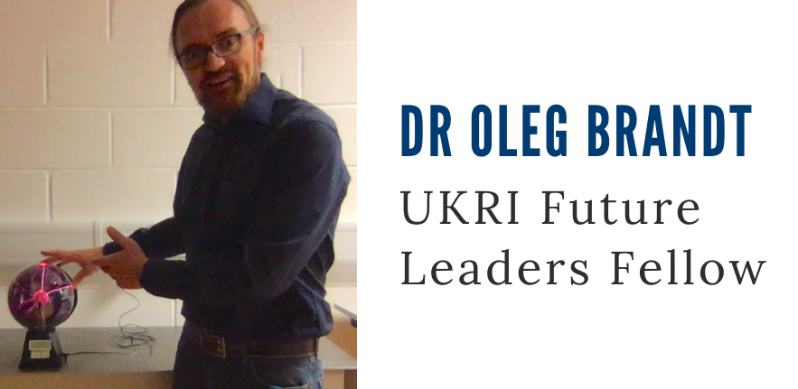 Dr Oleg Brandt, new UKRI Future Leaders Fellow, touching a plasma ball.